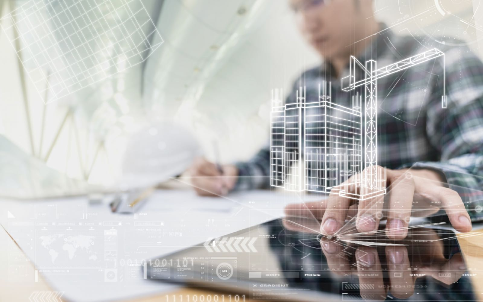man using technology to work on construction plans